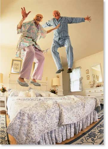 seniors laughing-jumping on bed
